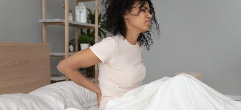 cómo dormir con dolor de espalda